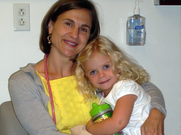 Woman holding young girl